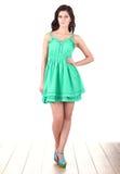 Fashion model wearing green dress Royalty Free Stock Photography