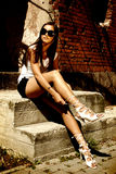 Fashion model wearing high hill shoes. Images of charming ladies in beautiful places Royalty Free Stock Images