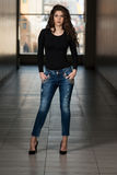 Fashion Model Wearing Jeans And Black Long Sleeve Royalty Free Stock Photo