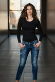 Fashion Model Wearing Jeans And Black Long Sleeve Stock Images