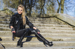 Fashion model wearing leather pants and jacket Stock Images