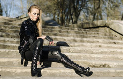 Fashion model wearing leather pants Stock Image