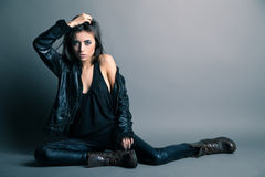 Fashion model wearing leather pants and jacket Stock Photos