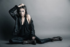 Fashion model wearing leather pants and jacket Stock Image