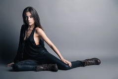 Fashion model wearing leather pants and jacket Royalty Free Stock Photos