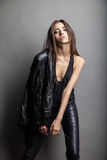 Fashion model wearing leather pants and jacket Royalty Free Stock Photo