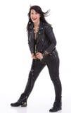 Fashion model wearing leather pants and jacket. Posing on white background Royalty Free Stock Image