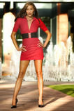 Fashion model wearing red dress Stock Photos