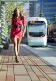 Fashion model wearing red dress Royalty Free Stock Photos