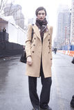 Fashion model wearing scarf Street Style during Fashion Week Royalty Free Stock Image