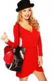 Fashion Model Wearing Red Outfit. A beautiful young blonde fashion model wearing a red dress with accessories stock photos