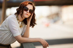 Fashion model wearing sunglasses outdoors Royalty Free Stock Photography