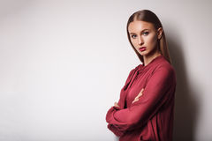 Fashion model on a white background. Portrait of beautiful young royalty free stock images