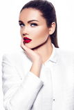 Fashion model in white coat with red lips Royalty Free Stock Photography