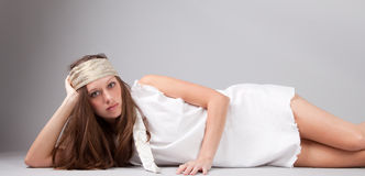Fashion Model in White Dress and Headscarf royalty free stock image