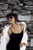 Fashion model in white jacket Stock Photography