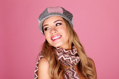 Fashion Model In Winter Accessories. Smiling fashion model wearing winter accessories with her head tilted upwards looking over her shoulder Royalty Free Stock Photo
