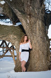 Fashion model in winter forest Royalty Free Stock Photos
