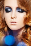 Fashion model. Winter glitter make-up, curly hair Royalty Free Stock Photo