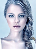 Fashion model with winter makeup. Beautiful young fashion model with winter ice style makeup Royalty Free Stock Image