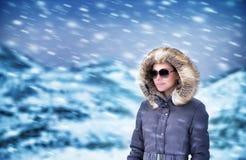Fashion model in winter mountains Stock Photos