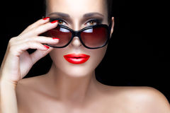 Fashion Model Woman in Black Oversized Sunglasses. Bright Makeup Stock Photo
