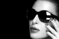 Fashion Model Woman in Black Oversized Sunglasses. Monochrome Po. Beautiful fashion model girl with stylish oversized black sunglasses. High fashion monochrome royalty free stock images