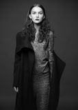 Fashion model woman coat and hat urban style pose Stock Photos