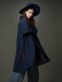 Fashion model woman coat and hat urban style pose Royalty Free Stock Image