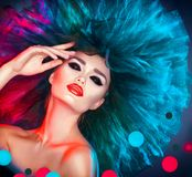 Fashion model woman in colorful bright lights posing. Beautiful girl with trendy makeup stock image