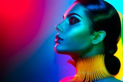 Fashion model woman in colorful bright lights posing. Portrait of girl with trendy makeup. Fashion model woman in colorful bright lights posing. Portrait of royalty free stock photos