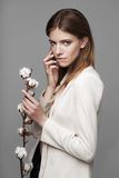 Fashion model woman with cotton plant balls in her Royalty Free Stock Photo