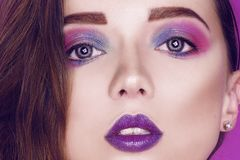 Fashion model woman creative pink and blue make up.  Beauty art portrait of beautiful girl with colorful abstract makeup. stock image