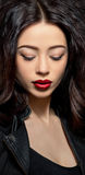 Fashion model woman with dark red lips in studio Stock Photography