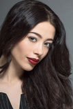 Fashion model woman with dark red lips in studio Royalty Free Stock Photos
