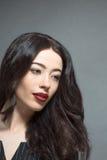 Fashion model woman with dark red lips in studio Stock Photo