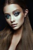 Fashion model Woman with fantasy make up. Long blowing brown hair. Stock Photos