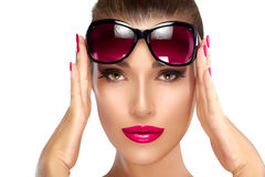 Fashion Model Woman Holding her Shades on Forehead Royalty Free Stock Image