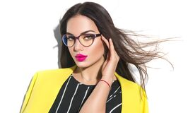 Fashion Model Woman In Glasses. Business Wear Look Style, Beauty Sexy Model Girl In Trendy Yellow Blazer Wearing Glasses Stock Photo