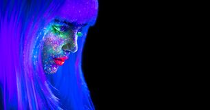 Fashion Model Woman In Neon Light. Beautiful Model Girl With Colorful Bright Fluorescent Makeup Isolated On Black. Ultraviolet Royalty Free Stock Images