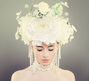 Fashion Model Woman with Makeup. And Flowers Stock Photo