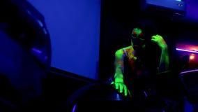 Fashion women in neon light, beautiful model girls with fluorescent makeup in UV light