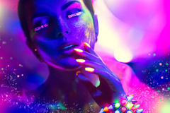 Fashion model woman in neon light Stock Photo
