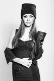 Fashion model woman posing wearing hat and black coat Stock Photo