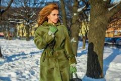 Fashion model woman in warm winter coat, romantic portrait stock photo