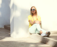 Fashion model woman wearing a sunglasses and yellow t-shirt Royalty Free Stock Images