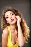 Fashion model  yellow dress against gray background Royalty Free Stock Photography