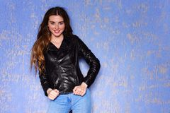 Fashion model young smile woman in black leather jacket. Punk, rock style fashion. Fashion model young smile woman in black leather jacket. Pixie cut hairstyle Royalty Free Stock Photo