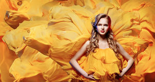 Fashion Model Young Woman, Girl Waving Fabric, Yellow Dress Stock Images