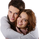 Fashion models as couple. Young attractive couple passionately in love holding isolated on white Stock Image